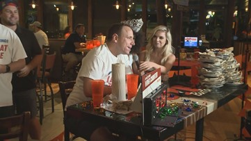 Hot dog-eating champ downs 413 wings in 12 hours in honor of National Chicken Wing Day