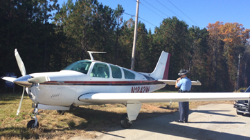 Airplane makes emergency landing on Ga. highway, pulls into parking lot