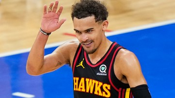 What a Father's Day gift: Trae Young gives dad his jersey after Game 7 win against Sixers