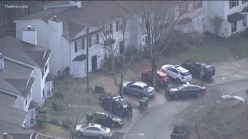 Police: 2 children, 2 men barricaded inside home