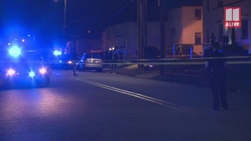 Police investigate discoverey of shooting victim outside apartment building