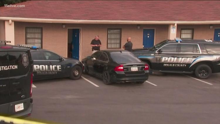 Bullets fly at metro Atlanta motel: 1 dead, 1 injured along busy highway
