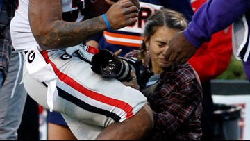 Photographer hit in Georgia-Auburn game released from hospital
