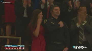 Covington officer shot in head gets standing ovation at State of the State address