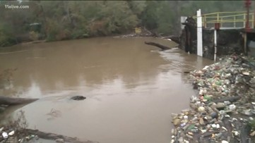 Rivers about to crest above flood stage, washing trash downstream