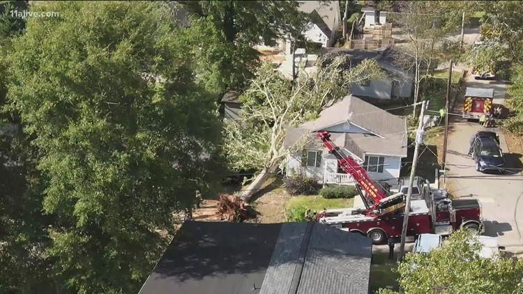 Identities released of 2 killed after tree crashed through Gwinnett home, landed on bed