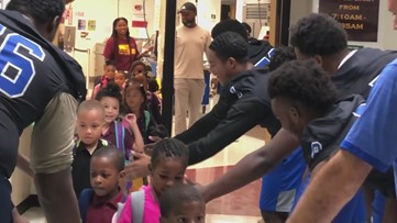 Local Varsity Football team pays it forward to elementary school