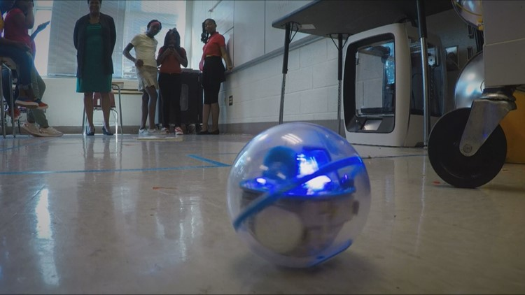 Girls programming robot in robotics STEM class at Young Middle School