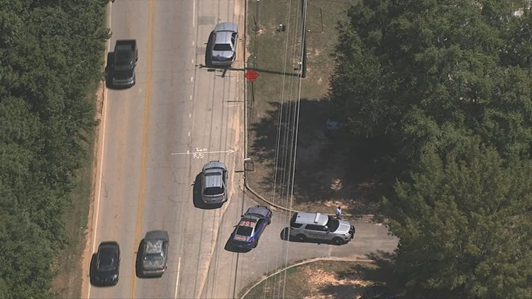 Two suspects in armed bank robbery captured after chase - two more still on the run