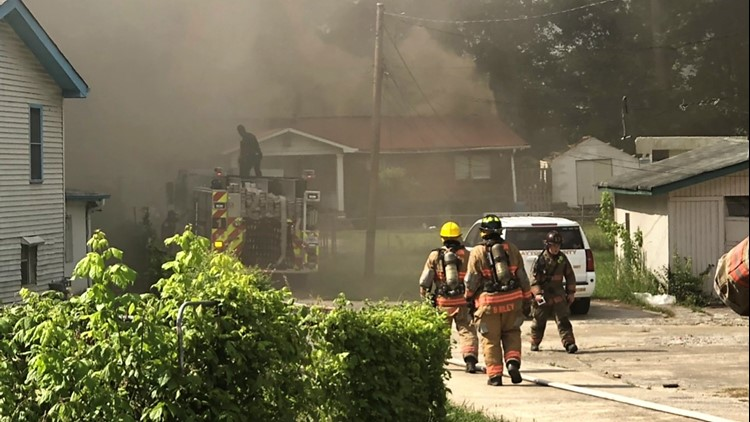 Crews clear neighborhood roadway to battle large house fire