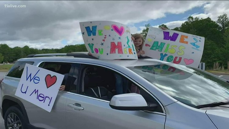 Families hold drive-thru parade for loved-ones at senior living facility