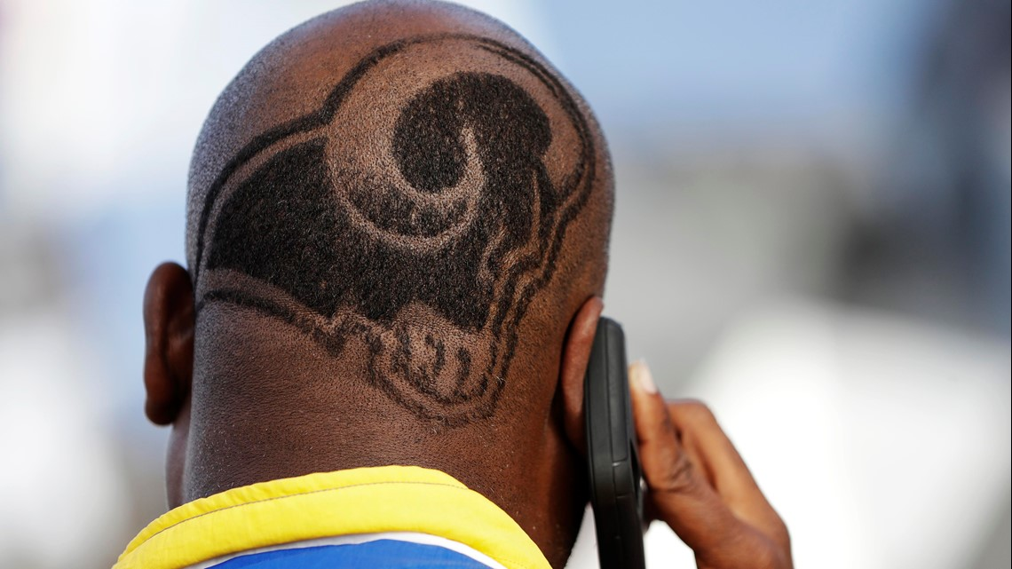 Sporting A L A Rams Haircut Damon Jackson Of Santa Ana Ca Talks On His Phone Before The Nfl Super Bowl 53 Football Game Between The Los Angeles Rams And