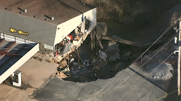 Massive sinkhole swallows Buford business