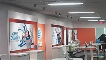 Surveillance video shows robbery at Conyers AT&T store