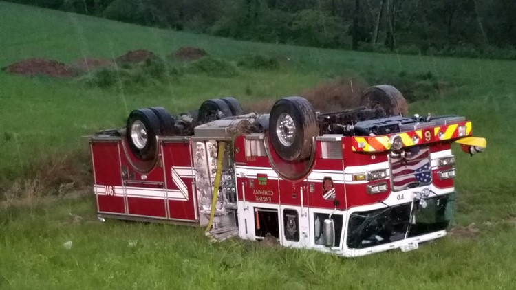 Four firefighters hurt, engine overturns while responding to house fire in Forsyth County