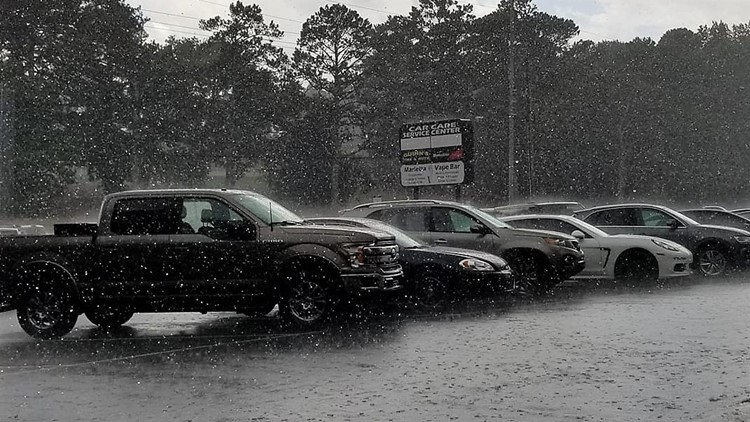 Rain inundates parking lot in Marietta, Georgia on June 20, 2019