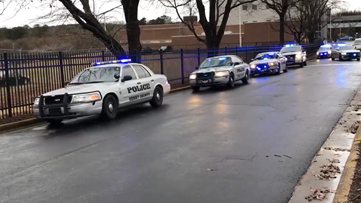 Officer Michael Smith's body escorted to funeral home