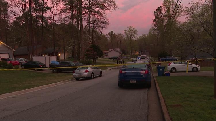 Gwinnett officers respond to report of woman screaming in driveway, find 2 men dead inside home