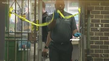Man shot dead, found at metro Atlanta convenience store