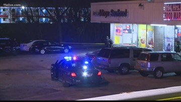 Woman shot in the head, left to die outside Atlanta strip mall