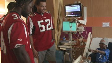 Falcons players, WWE Superstars bring smiles to Children's Healthcare of Atlanta patients