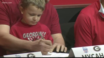7-year-old battling leukemia drafted by Georgia Bulldogs swim team