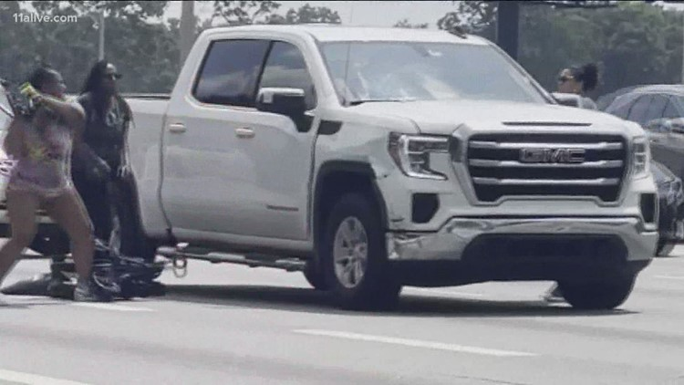 Good Samaritans break  truck windows to free driver having medical emergency on Atlanta interstate