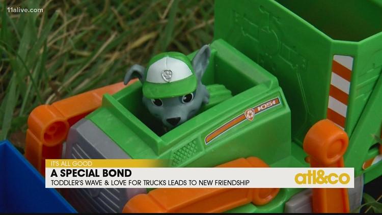 Toddler's Sweet Bond with Garbage Man