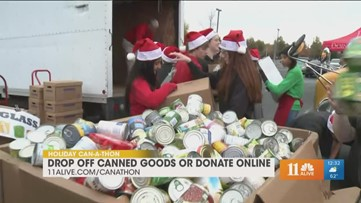 Middle schoolers drop off canned goods for Can-A-Thon