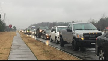Long lines form at new gas station for 76 cent gas
