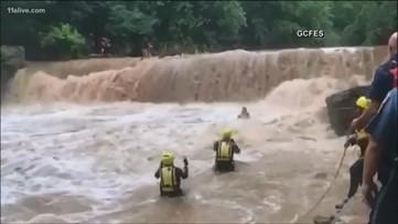 10 children narrowly escape being swept down a turbulent Georgia river