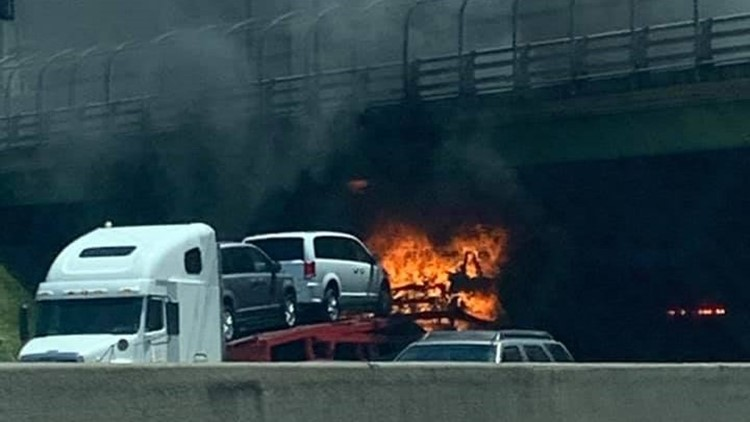 Traffic moving again after car carrier fire underneath overpass on I-285