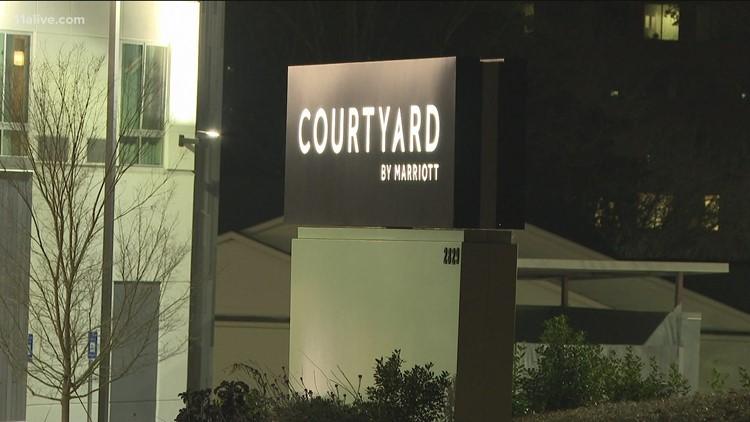 Man found shot dead near hotel parking deck in Vinings, police say
