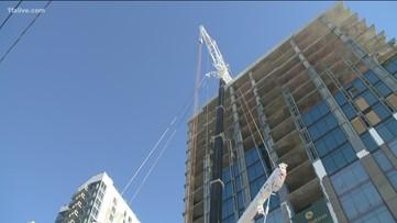 Unauthorized crane blocks Peachtree at Pharr Road