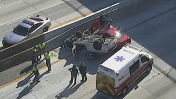Trooper's cruiser flips over in crash on I-285