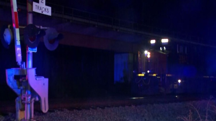 Man survives being hit by train with 'relatively minor injuries'