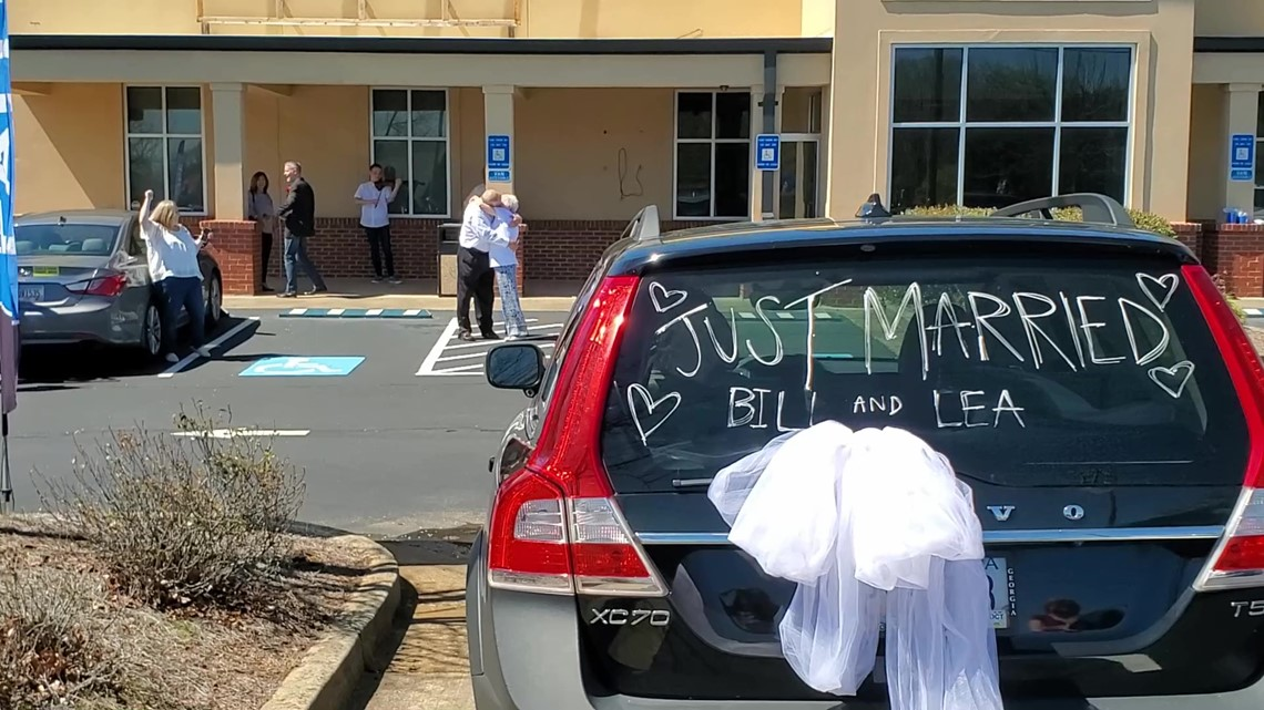 Newlyweds surprised with caravan of friends and family after canceling 200 plus wedding