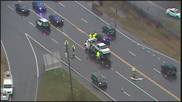 Man killed after being hit by 2 pickup trucks on Cobb Parkway