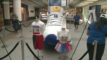 Artist creates 14-foot giant replica of official AJC Peachtree Road Race shoe