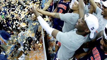 WATCH: Westlake's Chuma Okeke caps emotionally taxing week by raising Auburn's Final Four trophy