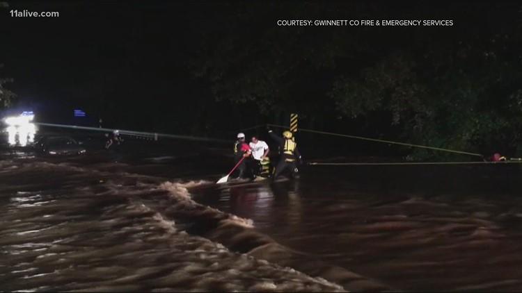 Firefighters rescue 2 from floodwaters in Gwinnett
