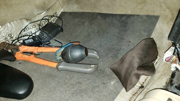 Officer says he was trying to put a stolen car in park. Then he saw what looked like a grenade