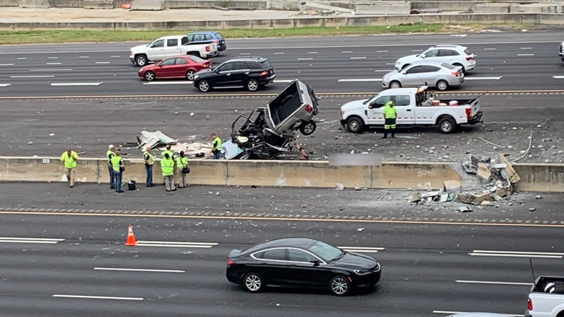 Person dies after truck crashes onto I-75 off overpass in Cobb County