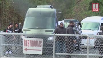 Colin Kaepernick arrives at Charles Drew High School in Riverdale, Georgia