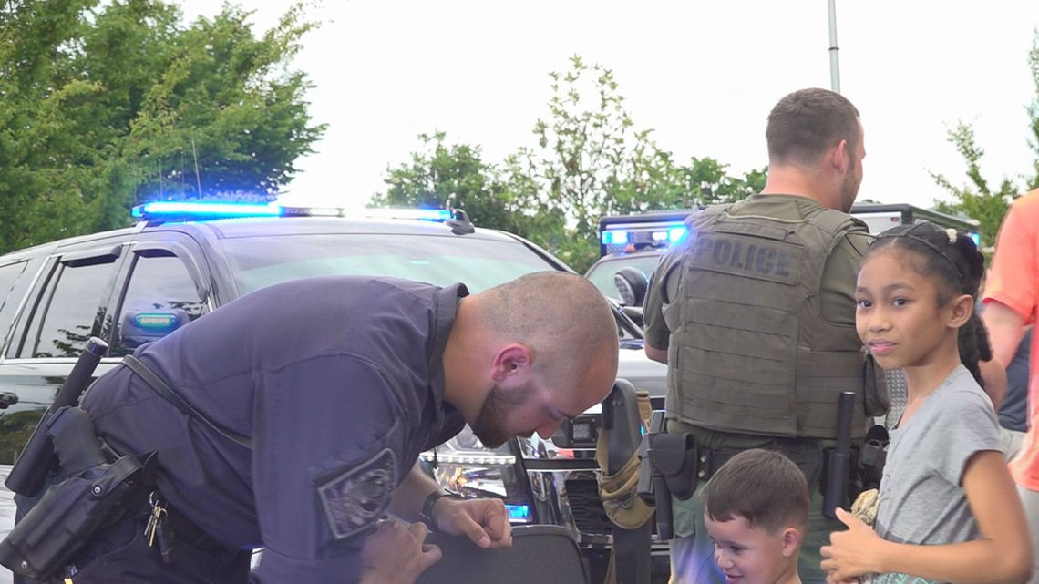Pizza with Police community outreach event receives great support despite rain
