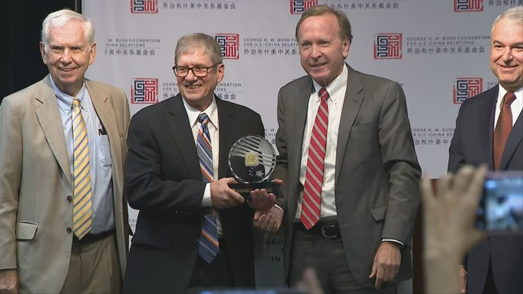 chip carter accepts award on behalf of his dad