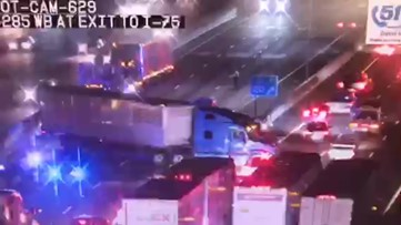 Timelapse of big rigs turning on I-285 after highway shuts down