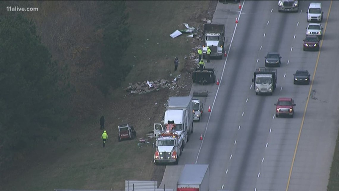 Two Fed-Ex trucks collide, spill packages on freeway