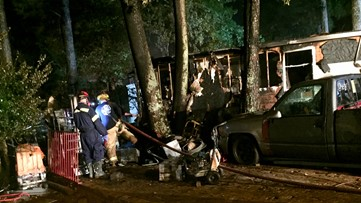 Three adults, child escape Norcross fire that burns down mobile home