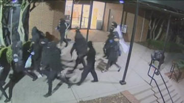Hammers, pickaxes and spray paint: Masked group attacks DeKalb government building